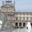 Stock Video: Tourists walk near fountains in front of Louvre