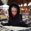 Woman looks at map in Paris North Station — Stock Video