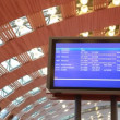Stock Video: Information board under arched ceiling of airport