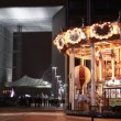 Carousel with illumination near Grand Arch of La Defense — Stock Video #27999737