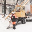 Municipal units with workers clean snow from street. — Stock Video #27999931