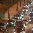 Cars in hard traffic jam on street of Moscow at night — Stock Video #27999971