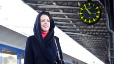 Woman at the train station waiting — Stock Video