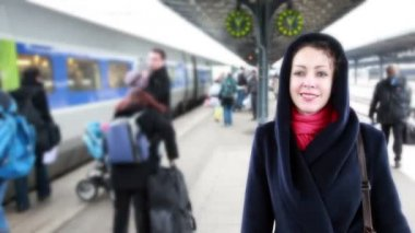 Woman meets on train station, seeking among guests — Stock Video