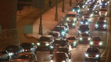 Cars in hard traffic jam on street of Moscow at night — Stock Video