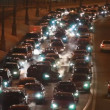 Cars in hard traffic jam on wintry street of city at night — Stock Video