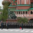 Stock Video: Soldiers march toward St. Basil's Cathedral on rehearsal of parade
