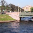 Stock Video: Boat floats under 2-nd Garden Bridge over channel in center of St. Petersburg