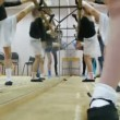 Group of girls stretching legs during dancing classes — Stock Video #28063749