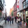 Stock Video: Trumpeter plays and people walk along Temple Bar