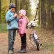 Little boy with mobile phone and girl stand in park. — Stock Video #28064171
