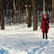 Girl in winter forest runs through snow — Stock Video