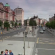 Touristic bus moves along the O'Connell street. — Vídeo de stock