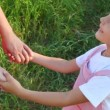 Stock Video: Girl and mother have joined hands in park