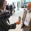 Man is being interviewed by a journalist on CEPIC Congress — Stock Video