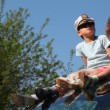 Boy in captain's cap and his sister sit on roof of car — Stock Video