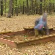 Boy play in wooden sandbox making molds — Stock Video