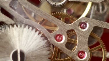 Moving gears inside working watch mechanism closer — Stock Video