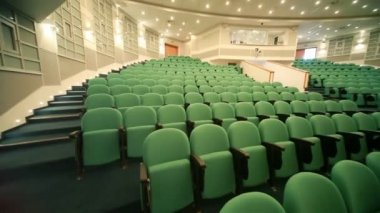 Panning of empty auditorium with seats — Stock video