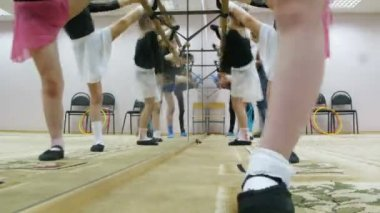 Group of girls stretching legs during dancing classes — Stock Video