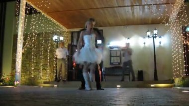 Newlywed couple dance and then look at fireworks at party — Stock Video