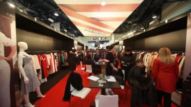 Visitors in pavilion of Austria on CPM Collection Premiere in Expo center — 图库视频影像