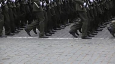 Legs soldiers march in rows on pavement at military parade — Wideo stockowe