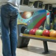 Family play bowling in PLANET club — Stockvideo