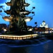 Bottom illuminated monument to Peter Great and fountains on River — Stock Video