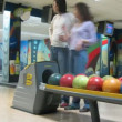 Family play bowling in PLANET club — Stok video