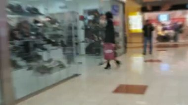 Walk in circles around the bright trade center passage — Stock Video