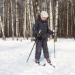 Stock Video: Young boy turns on skis around its axis