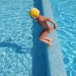 Stock Video: Girl prepared and jumped into water, came back and did it again