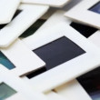 Bunch of slides in white framed rotates clockwise — Stockvideo