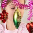 Little girl examine christmas-tree decoration, which hang. — Видео