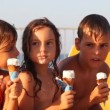 Three kids eat ice cream in waffle cone — Stock Video