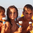 Three kids eat ice cream in waffle cone — Stock Video #28797649