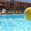 Large ball floats on water in the pool — Stock Video