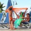 Mom and kids are sitting in deckchairs, and playing with cloth — Stock Video #28797721