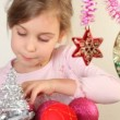 Little girl play with christmas-tree decoration — Stock Video #28797885