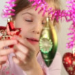 Little girl play with christmas-tree decoration, which hang. — Vídeo Stock