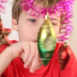 Boy play with christmas-tree decoration. — Stock Video #28798371