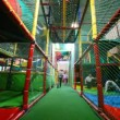Children run on a labyrinth in big playroom of childrens club — Stock Video