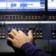 Stock Video: Hand of sound producer moving lie on mixer panel.
