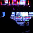 Stock Video: Sound producer sits at mixer panel