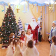 Girls in snowflakes fancy-dress act nearby christmas-tree — Stock Video