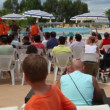 Animation team entertains a group of tourists — Vídeo de stock