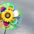 Toy with sunflower in center, that spins on the background of sky — Stock Video #28798899