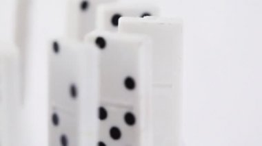 Dominoes with black dots stand vertically and pass consistently in front of camera — Stock Video