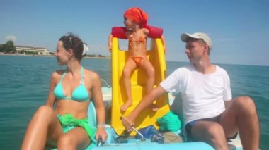 Father, mother and daughter sailing on catamaran — Stock Video